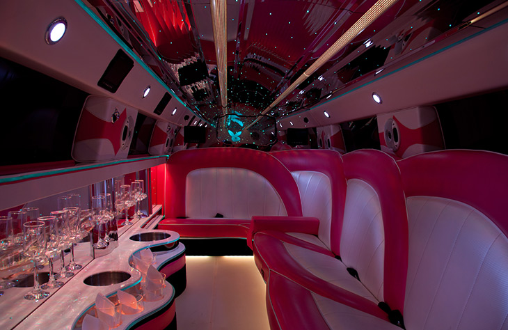 Pink limo bus hire